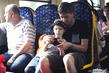 Отец показывает сыну, как обращаться с камерой.